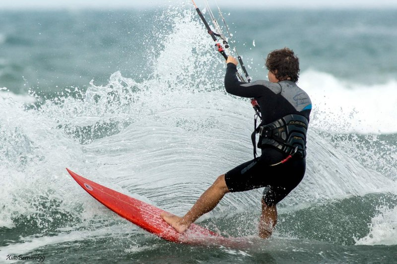Kite surfer carving a wave