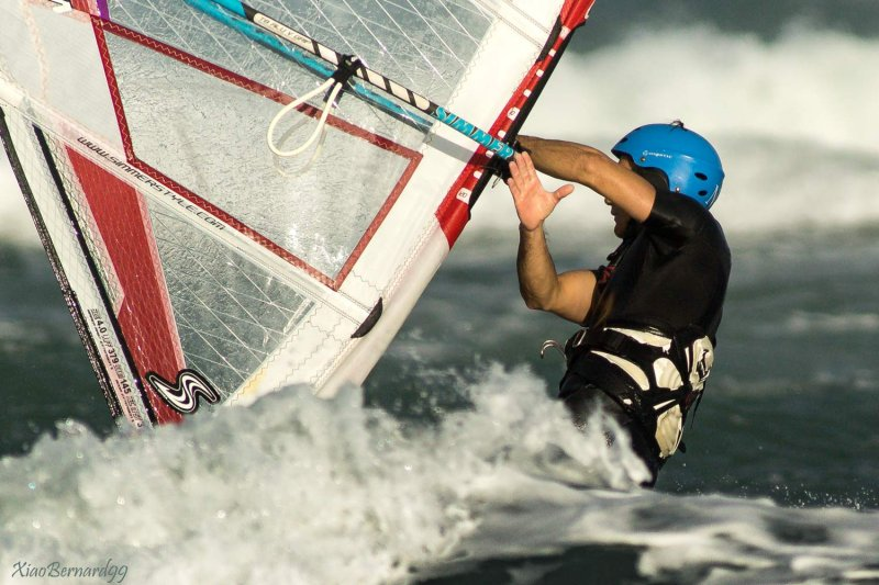Wind surfer and the sign of the Hand
