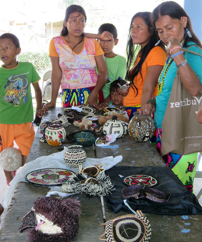 Embera Women Selling baskets and masks