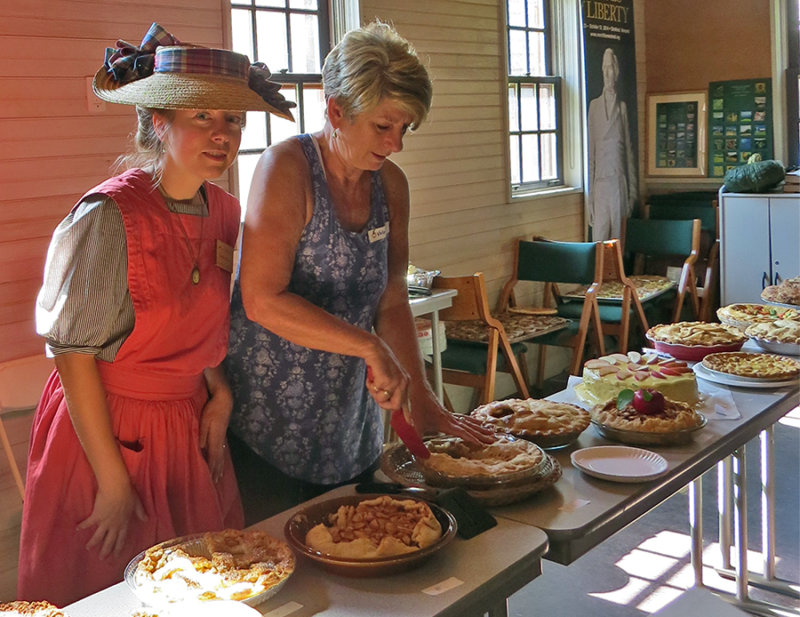 Emily Howe and Nancy C.DeFeudis with Apple Pies