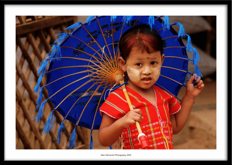 Little girl with umbrella, Mandalay, Myanmar 2014