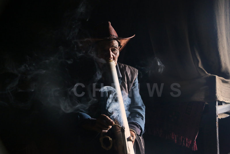 Man smoking, QingKou village