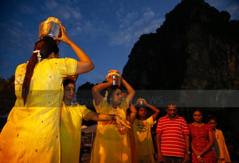 Devotees carry milk pots on the head