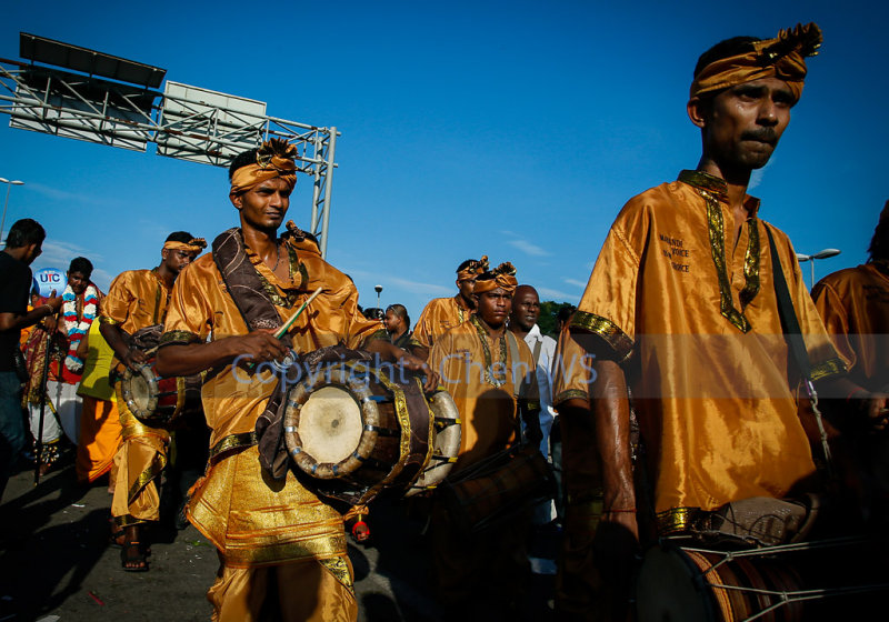 The urumi melam drums band accompany devotees on their walk