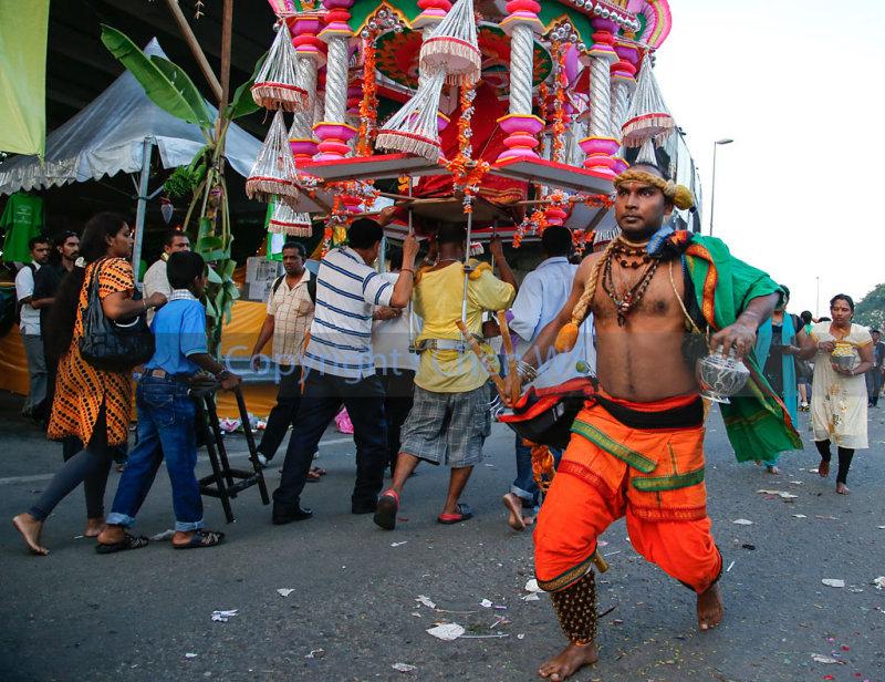 Devotee walks elegantly towards the Batu Caves temple