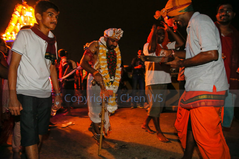 Devotee pulling a cart by hooks on his back