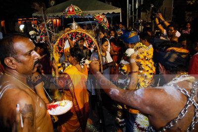 Performing rituals in preparation for the walk up Batu Caves