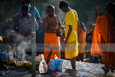 Cleansing ceremony on the river bank