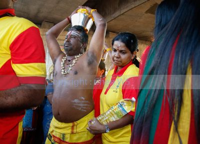 Man carries Pal Kodum or milk pot