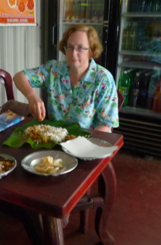 Tucking into a banana leaf curry
