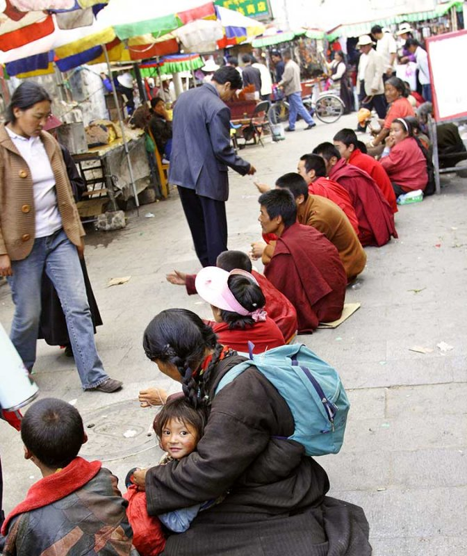 In Lhasa Tibet, monks, children and mothers begging for money.