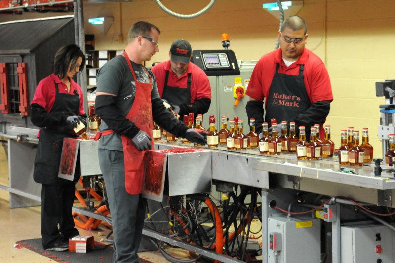 Dipping bottles at Makers Mark distillery