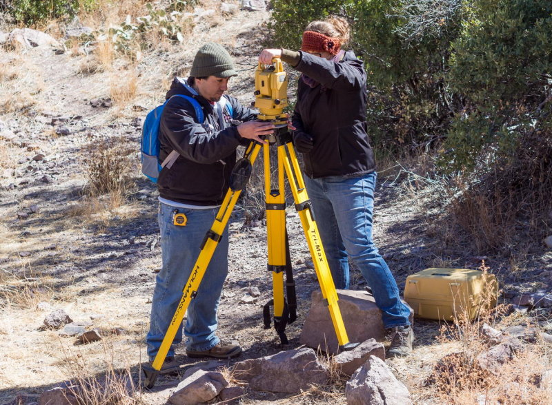 Chris Diaz and Kristin Corl, setting up the total station