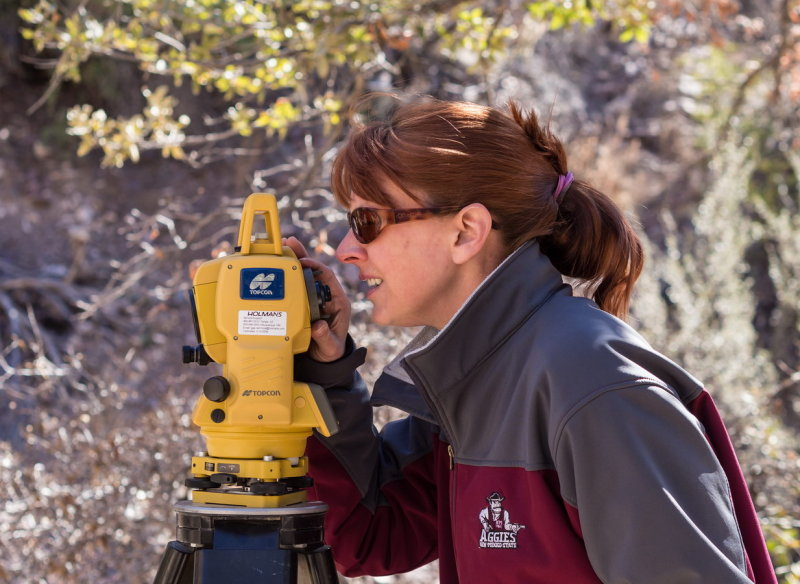 Kari Richards using the total station