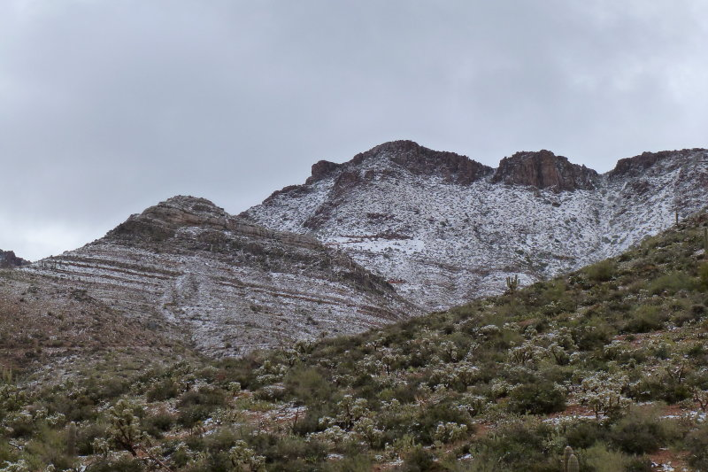 Snow-covered mountains visible from Apache Leap Road