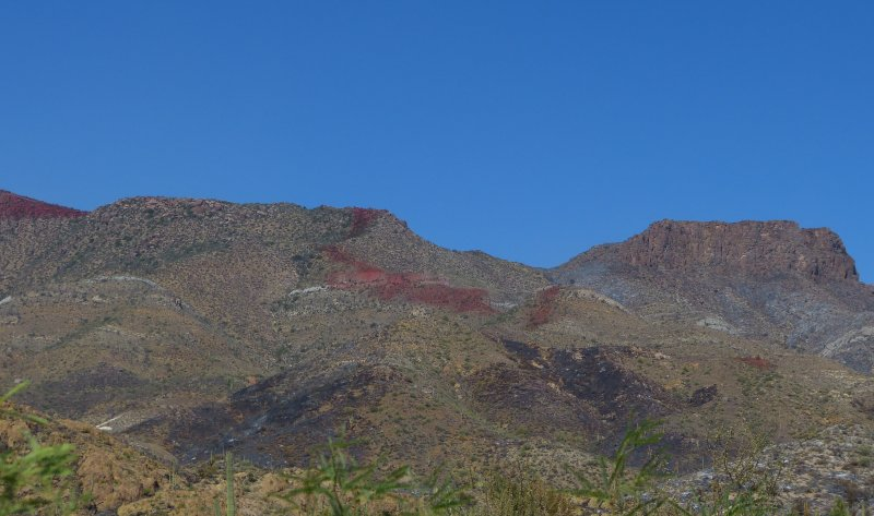 A strip of fire retardant from the 257 Fire passes near Little Leap
