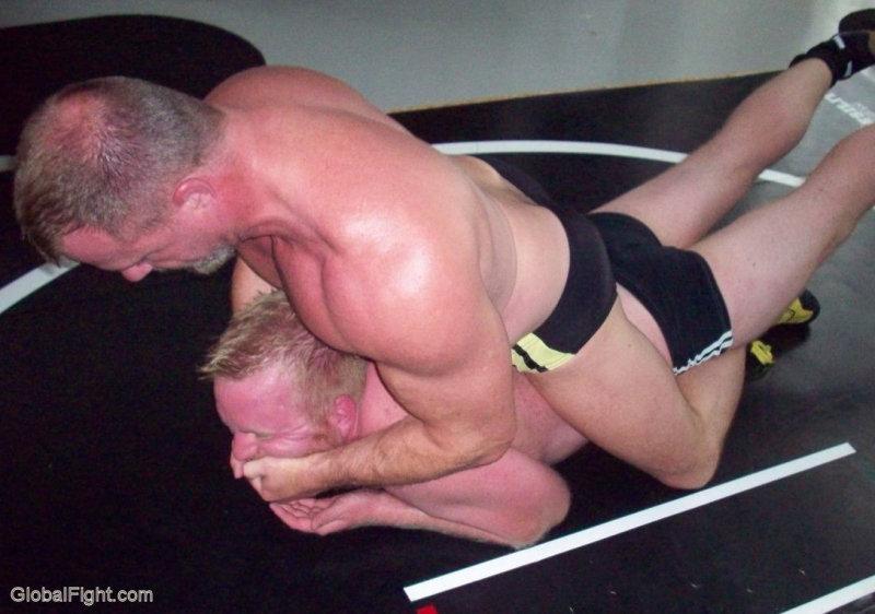 big muscleman choking younger jobber.jpg
