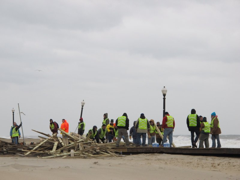 volunteers helping clear the debris and damage on the boardwalk