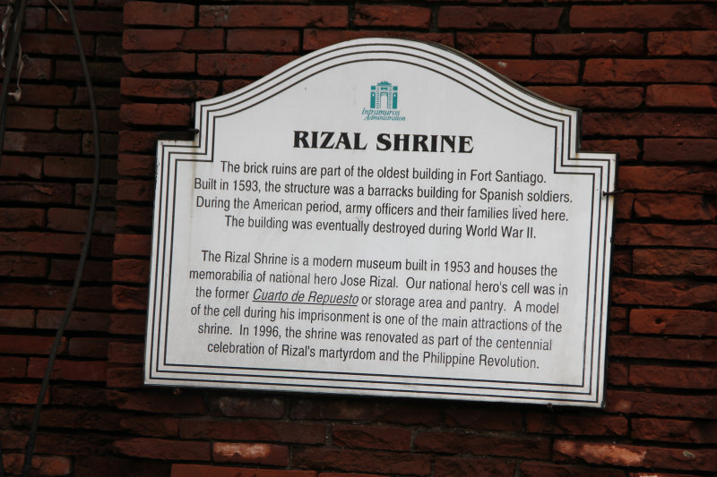 Sign describing the ruins and that the Rizal Shrine is a museum built in 1953.