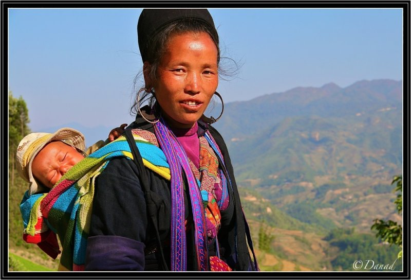 A Black Hmong and his Baby on the way to Cat Cat.