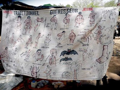 Advertisement of the traditional healer Amadou Jebre in a market in Toumousseni, Burkina Faso.