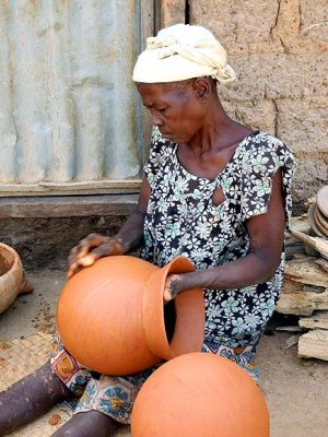 Handmade pots are decorated with colour and simple patterns made with corncobs. Pottery village Sitiana, Burkina Faso