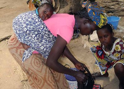Mother with baby in a market, Burkina Faso