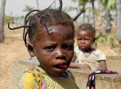 Fancy hairstyle of a little girl in Burkina Faso