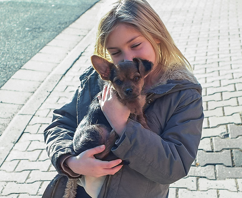 Girl with Puppy Leo