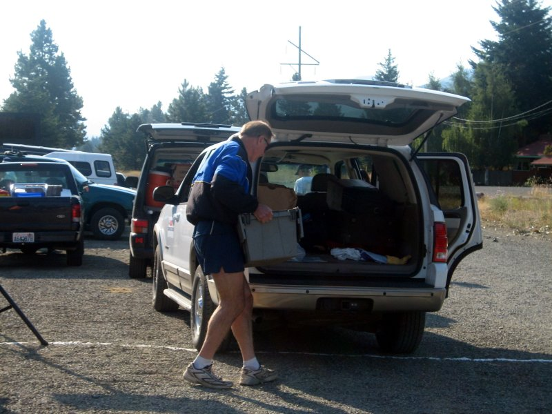 Tropical John loads the aid station supplies into his truck for delivery