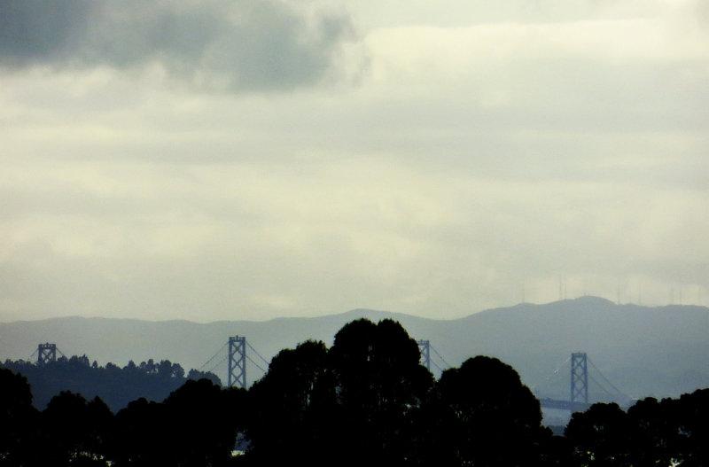 SF Bay Bridge on left. Day 1, 500mm equiv handheld, w/ default, heavier compression.  0015r.