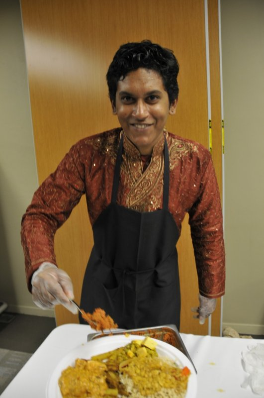 person serving food at Indian Night _DSC7241.jpg