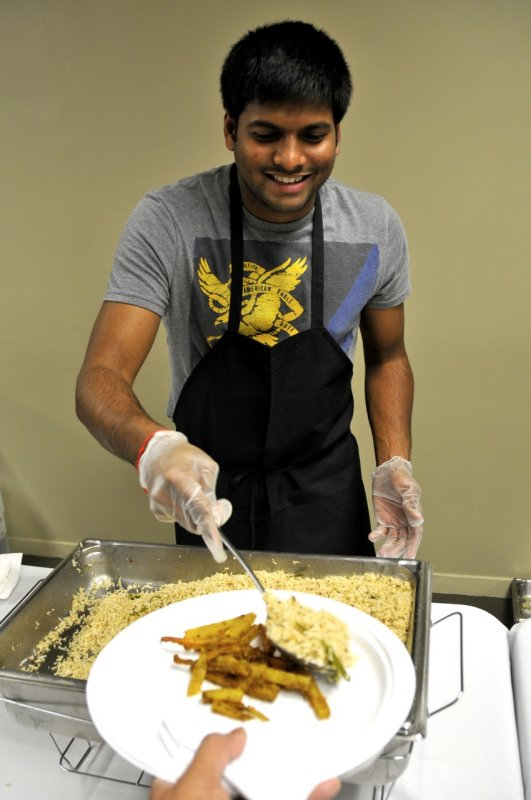 Person serving food at Indian Night at ISU _DSC7227.jpg