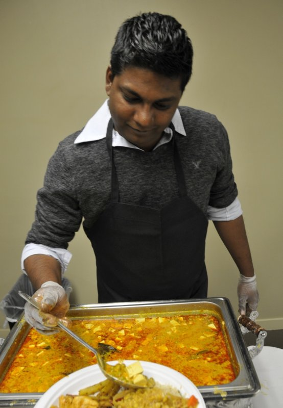 person serving food at Indian Night at ISU _DSC7238.jpg