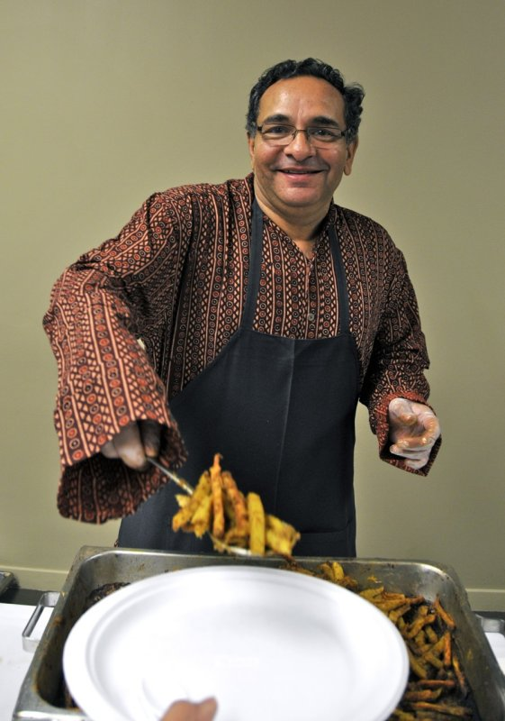 Prof Bhushan serving food at Indian Night _DSC7219.jpg