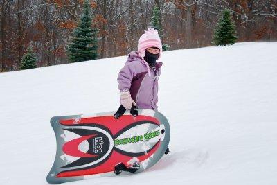 Caitlin goes sledding