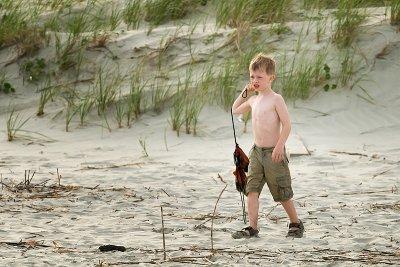 Ryan walks isle of palms beach collecting shells