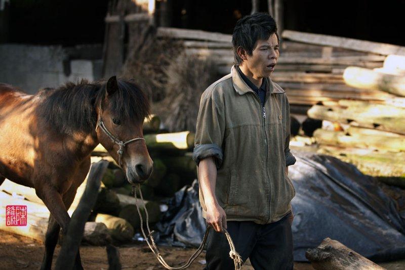 Farmer and horse, Long Ji, China.