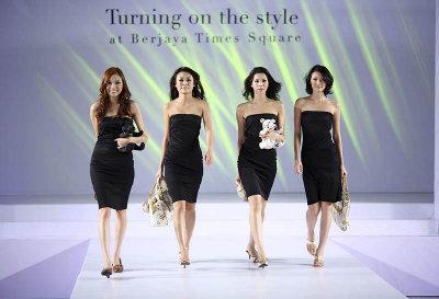 KUALA LUMPUR - JULY 01: Models walk down the run walk in a fashion show Turning on the style presented by Berjaya Times Square