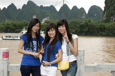 Young girls visiting Xing Ping on the Li Jiang River.