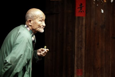 Old man in Xingping old town.