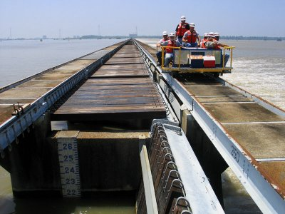 Crew Returns from Closing Five Bays as Gauge Shows a Foot Drop in River