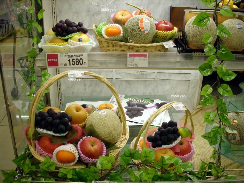 The fruit is gorgeous, but expensive.  Thats about $43US for that large basket of fruit, $14US for the small one top left.