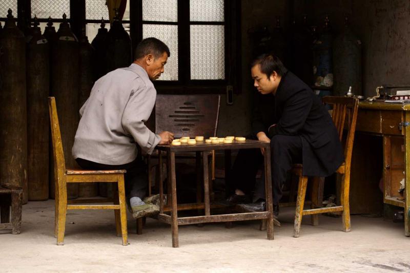Playing Chinese Checkers. Jishou City, Hunan Province, China