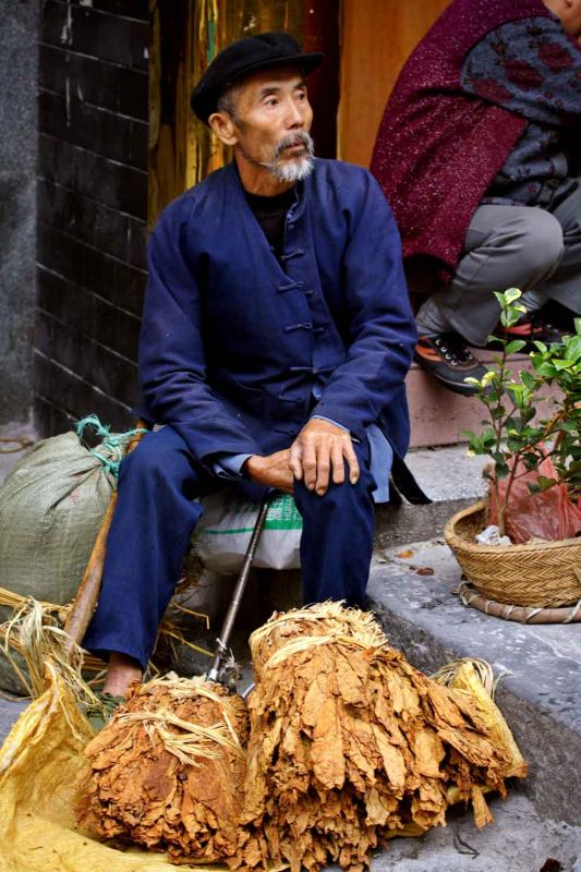 Selling tobacco leaves. Jishou City, Hunan Province, China