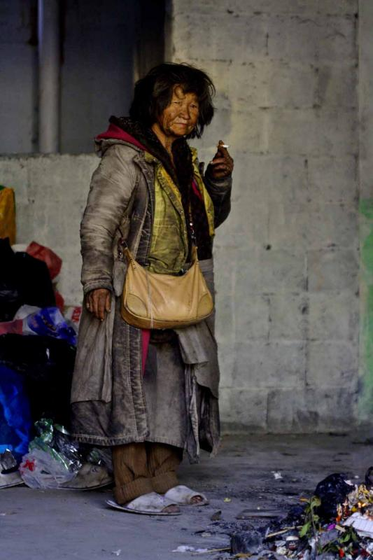 Elderly homeless person at temporary home.