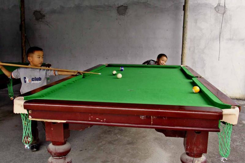He had a pretty good eye and was clearing the table.   Jishou City, Hunan Province, China