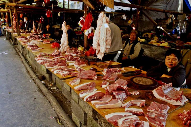 Outdoor meat market. Jishou City, Hunan Province, China