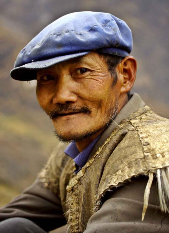 Elder herdsman in mountains at Tiger Leaping Gorge China .jpg