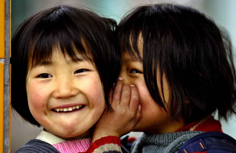 Two girls telling a secret, Ping Shan Po